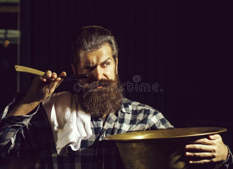 Bearded man shaves with razor royalty free stock photos
