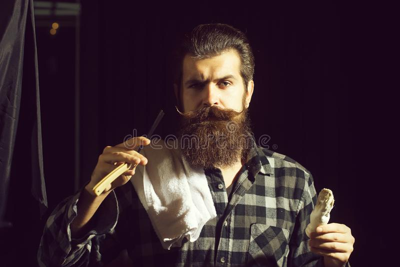 Bearded man shaves with razor royalty free stock image
