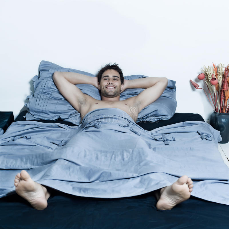 Handsome Man In A Bed Royalty Free Stock Photography