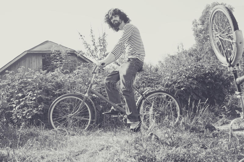 Download Handsome man on bicycle stock image. Image of space, collage - 25131895