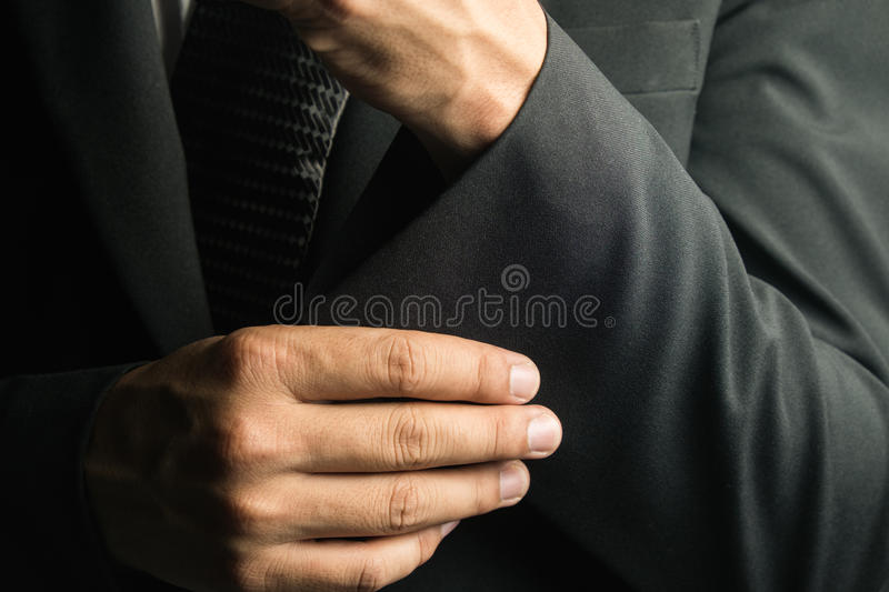 Handsome man in black suit on a black background royalty free stock photos