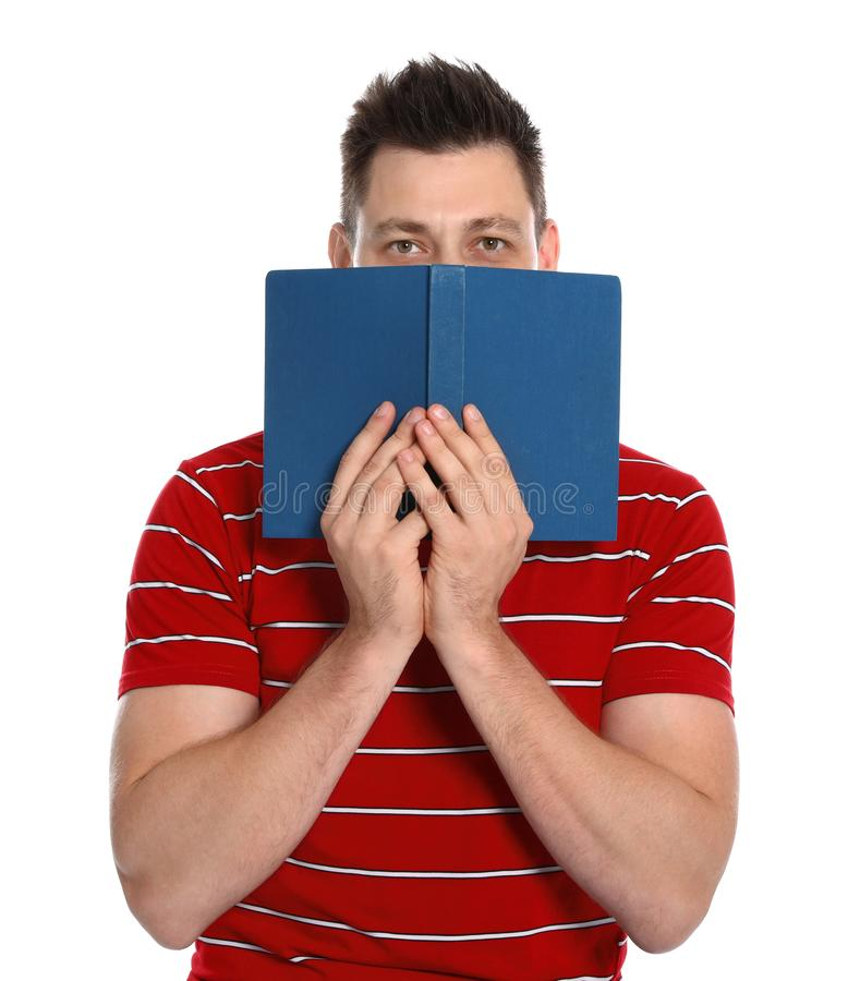 Handsome man with book on white background stock image