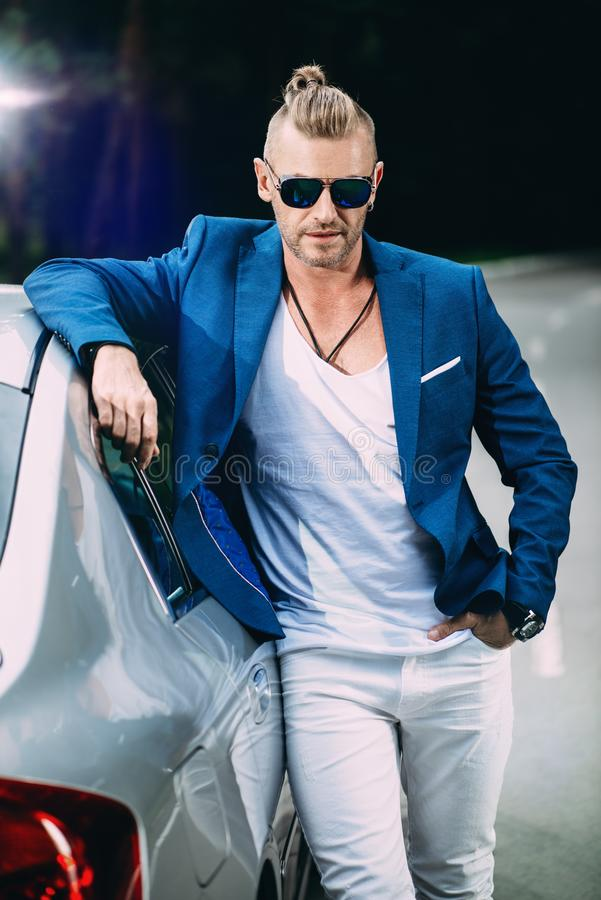 Handsome man by car royalty free stock photo
