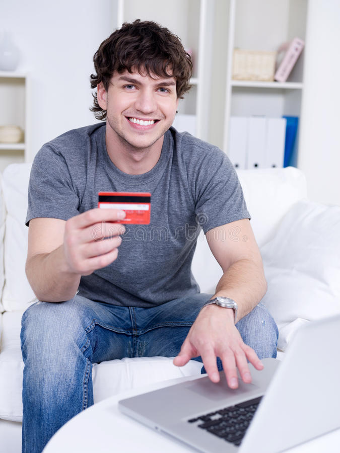 Handsome man with credit card stock photo