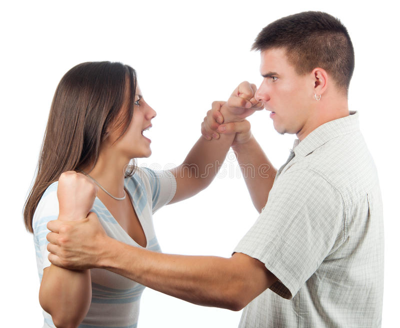 Handsome man defending himself from angry woman. Handsome young men defending himself from angry women isolated on white royalty free stock photo