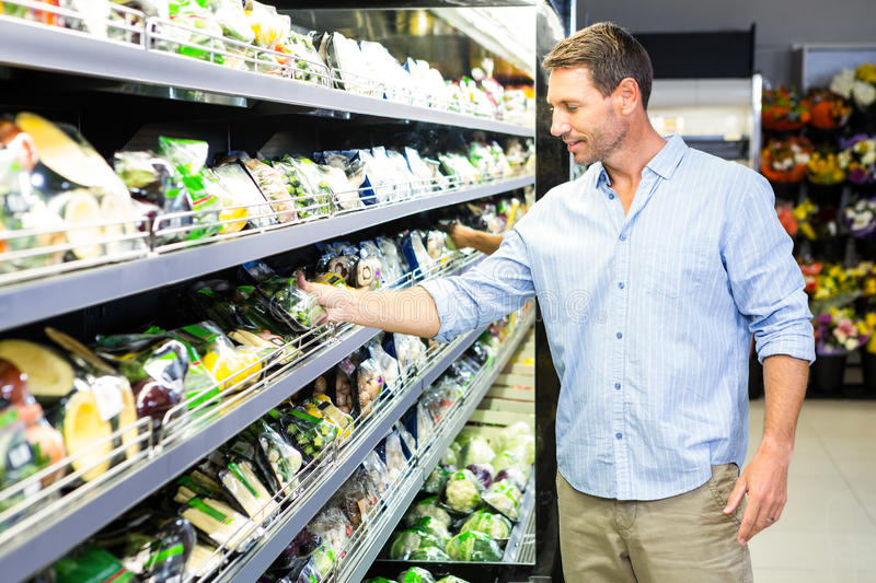 Handsome man doing grocery shopping royalty free stock images
