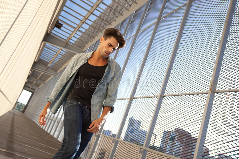 Download Handsome Man Dressed Casual In A Grungy Location Stock Photo - Image: 16263830