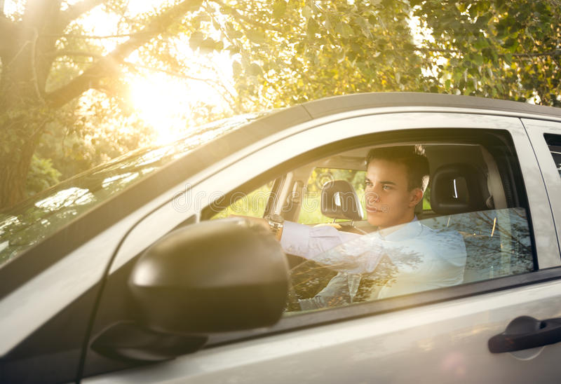 Handsome man driving car stock photos