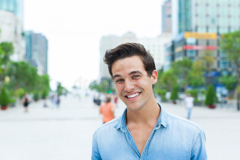 Handsome man face smile outdoor city street stock image