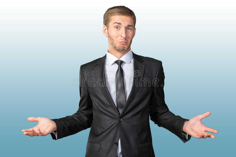 Handsome man gesturing 'I don't know' stock images
