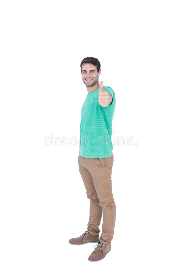 Handsome man gesturing thumbs up royalty free stock image