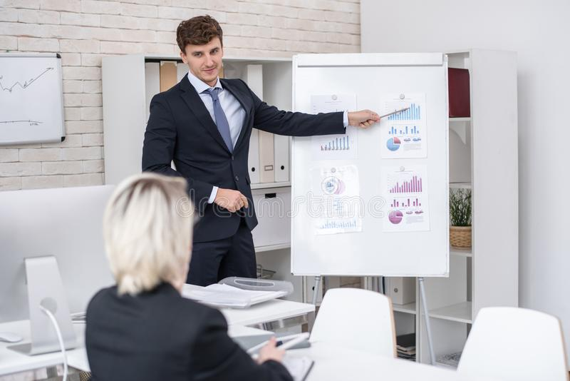 Handsome Man Giving Business Presentation in Office stock photography