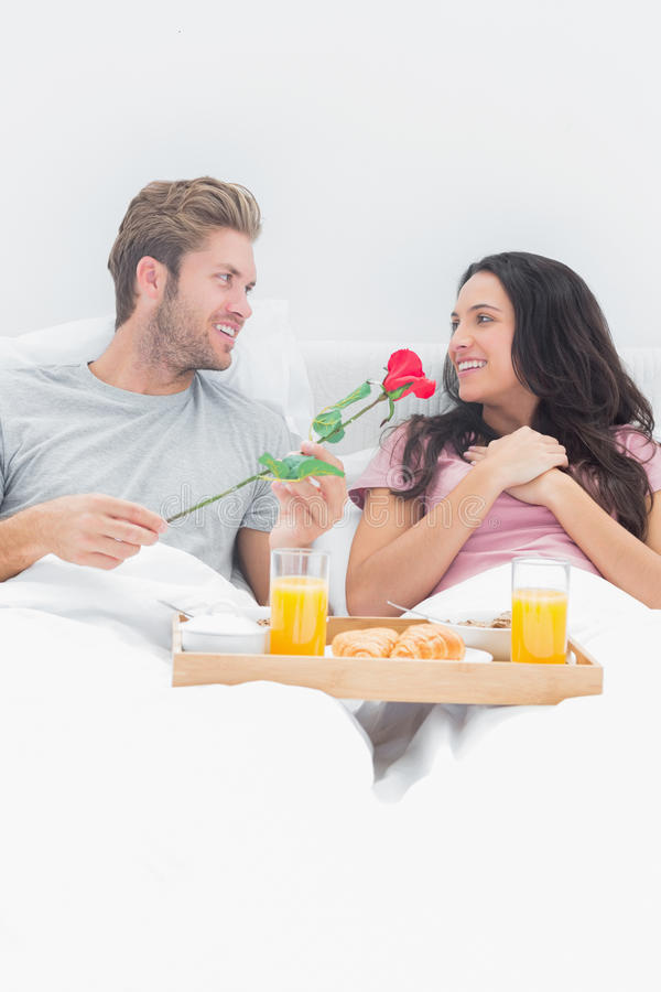Handsome Man Giving A Rose To His Wife Royalty Free Stock Photography