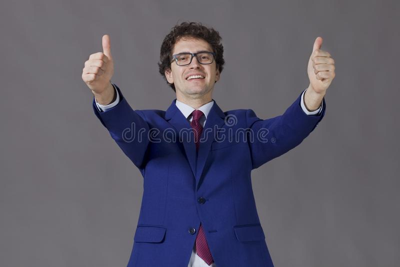 Happy handsome man showing big thumbs up stock photo
