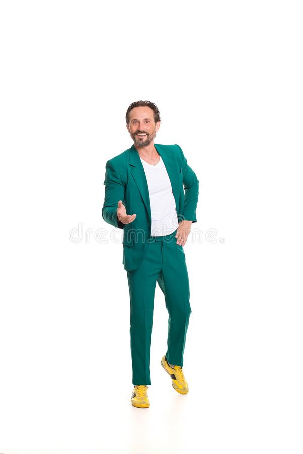 Handsome man in green suit. Isolated on white background royalty free stock images
