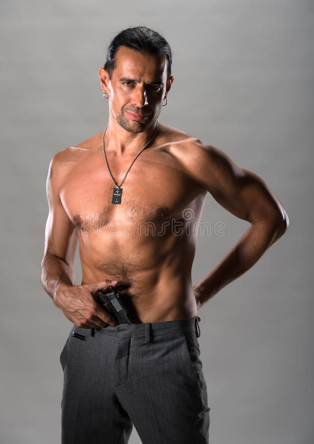 Download Handsome man with a gun stock photo. Image of macho, assassin - 33463798