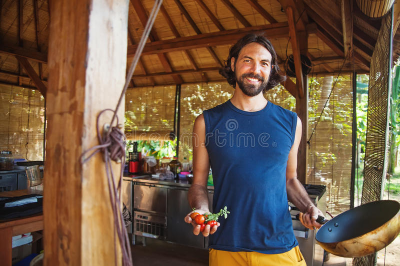 Handsome man with handful of freshly picked tomatoes royalty free stock photo