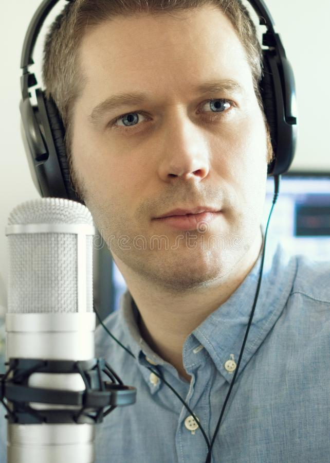 Handsome man. Handsome man near microphone on the radio station royalty free stock photo