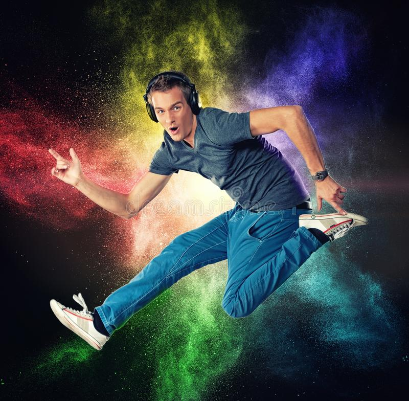 Handsome man with headphones jumping royalty free stock photo