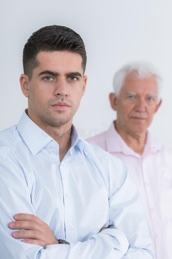 Handsome man and his father royalty free stock photo