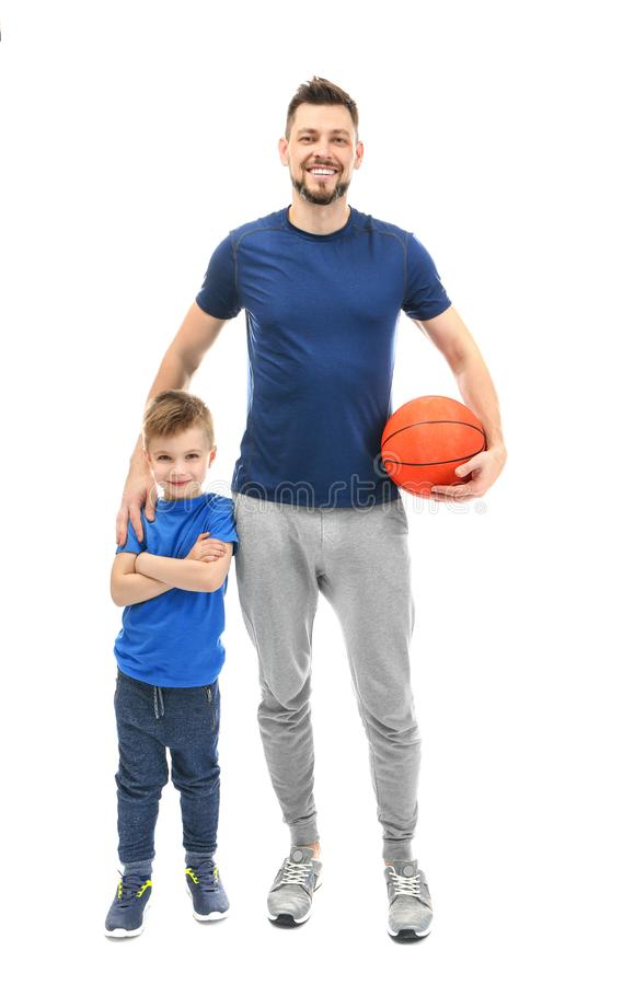 Handsome man and his son with ball on background royalty free stock photography