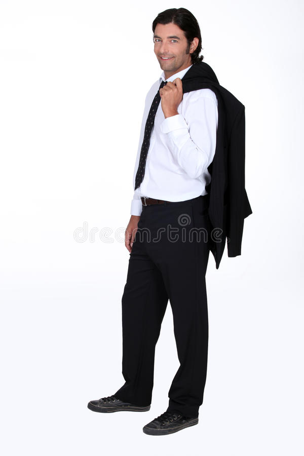 Handsome man. With his suit jacket flung over his shoulder stock image