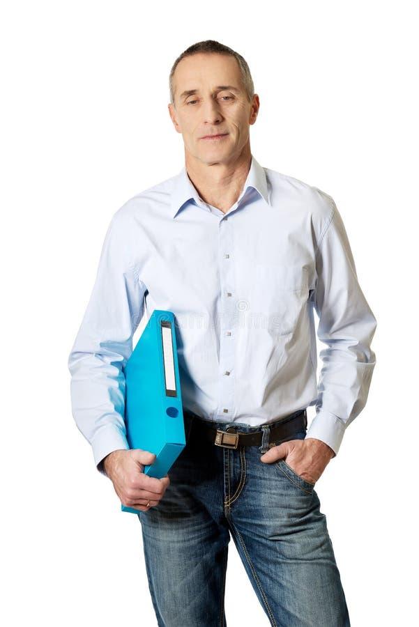 Handsome man holding blue binder.  stock images