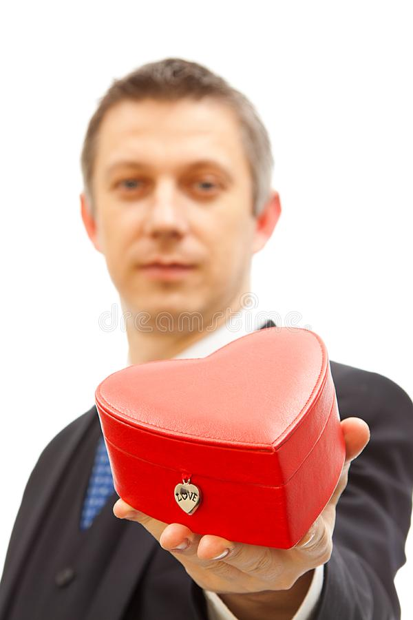 handsome  man holding a red heart box royalty free stock images
