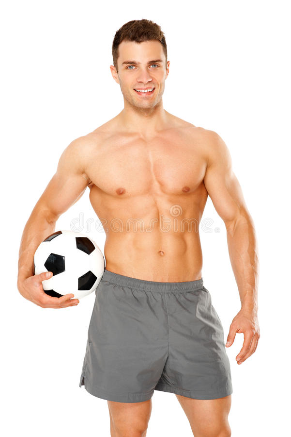 Handsome man holding soccer ball on white royalty free stock photography