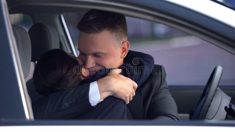 Handsome man hugging loving woman in car, romantic date, sweetness in relations. Handsome men hugging loving women in car, romantic date, sweetness in relations royalty free stock image