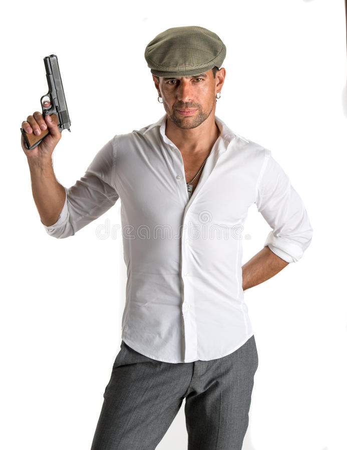 Free Handsome Man In Cap With A Gun Royalty Free Stock Image - 33676296