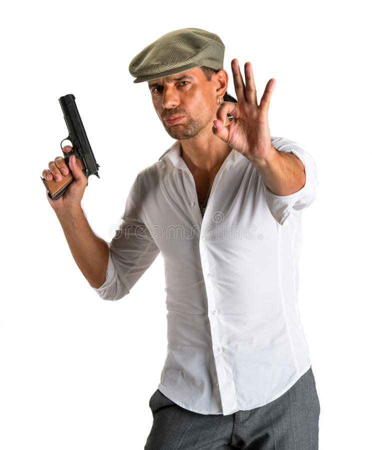 Free Handsome Man In Cap With A Gun Royalty Free Stock Image - 33676336