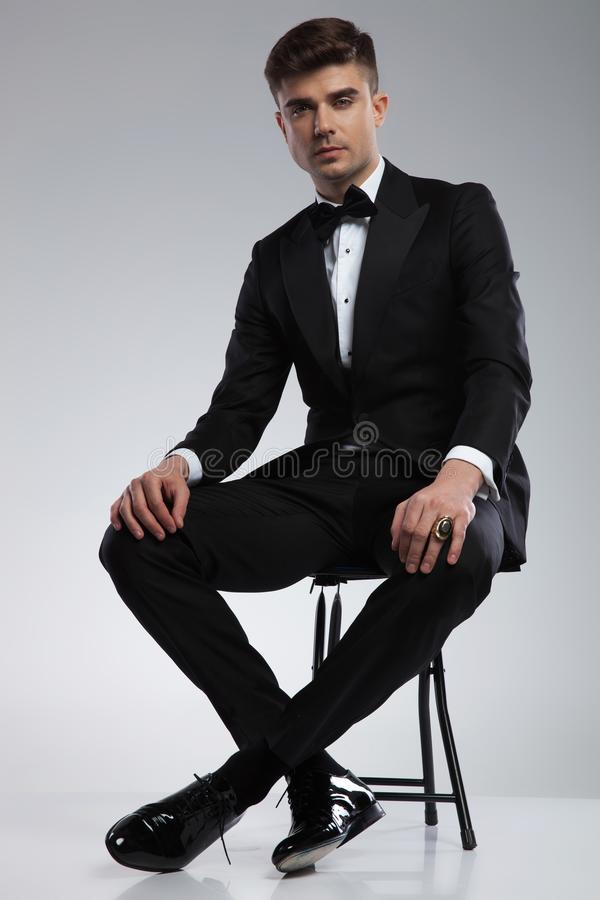 Free Handsome Man In Tuxedo Resting On Metal Chair Royalty Free Stock Photo - 118061445