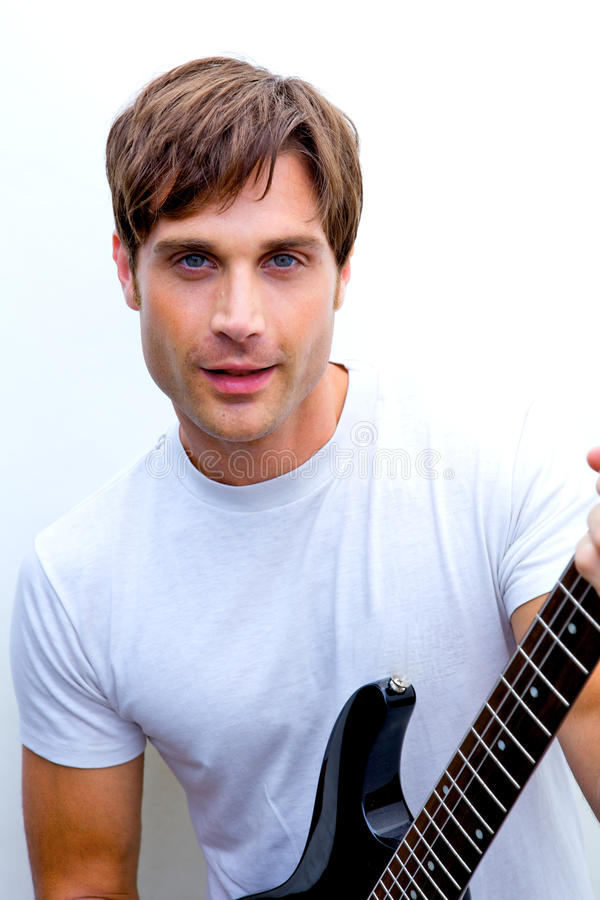 Handsome man jamming out. A handsome man jamming out to music stock photo
