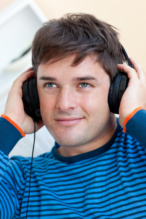 Download Handsome Man Listening Music With Earphones Royalty Free Stock Images - Image: 16347039