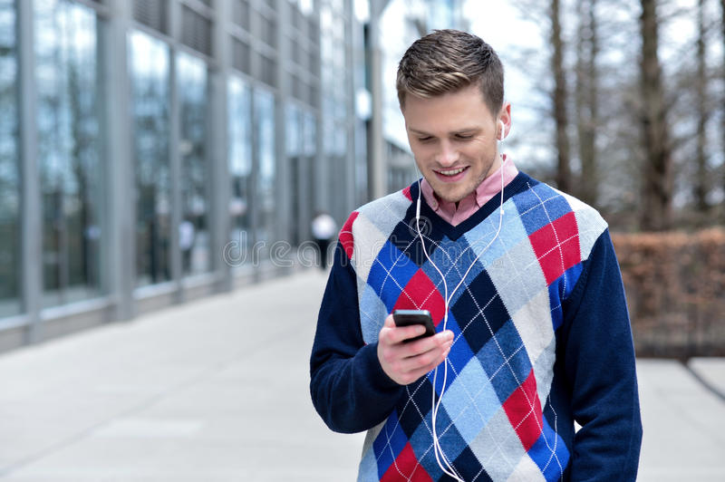 Download Handsome Man Listening To Music At Outdoors Stock Photo - Image: 39855018