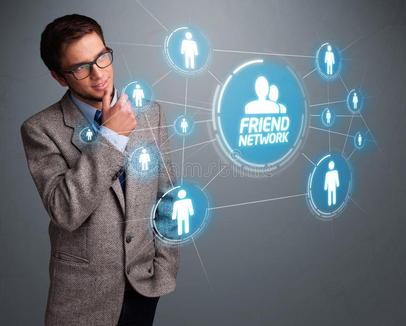 Handsome man looking at modern social network stock images