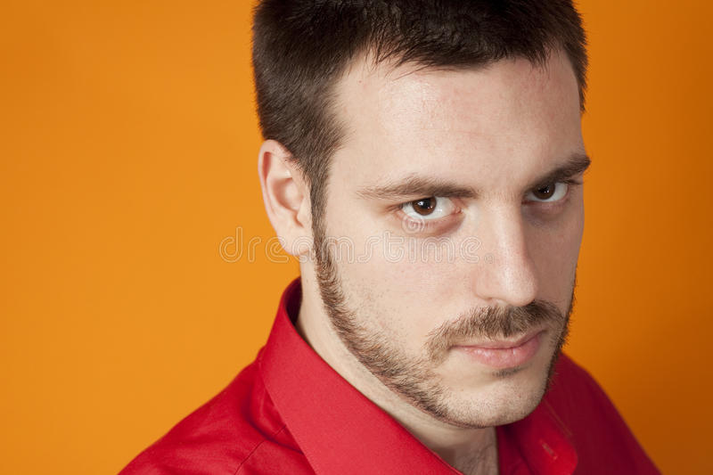 Handsome man with macho expression royalty free stock photo