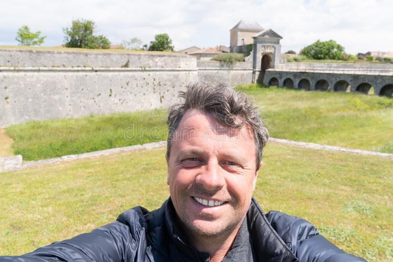 Handsome man making selfie in tourism day in island ile de Re in french country France. An Handsome man making selfie in tourism day in island ile de Re in royalty free stock photo
