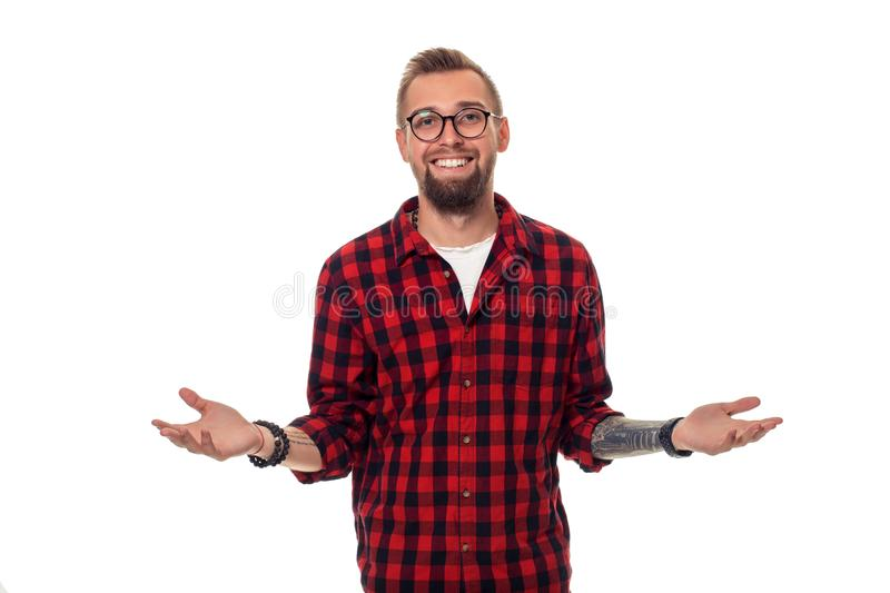 Handsome man model studio portrait. Boy casual style, trendy hipster in checkered shirt look with cool hairstyle royalty free stock photo