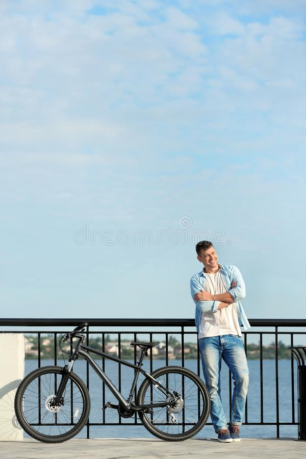 Handsome man with modern  near river royalty free stock image