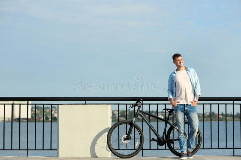 Handsome man with modern bicycle royalty free stock photo
