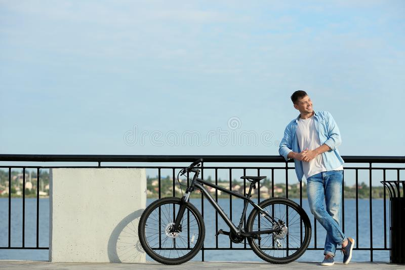 Handsome man with modern bicycle stock photography