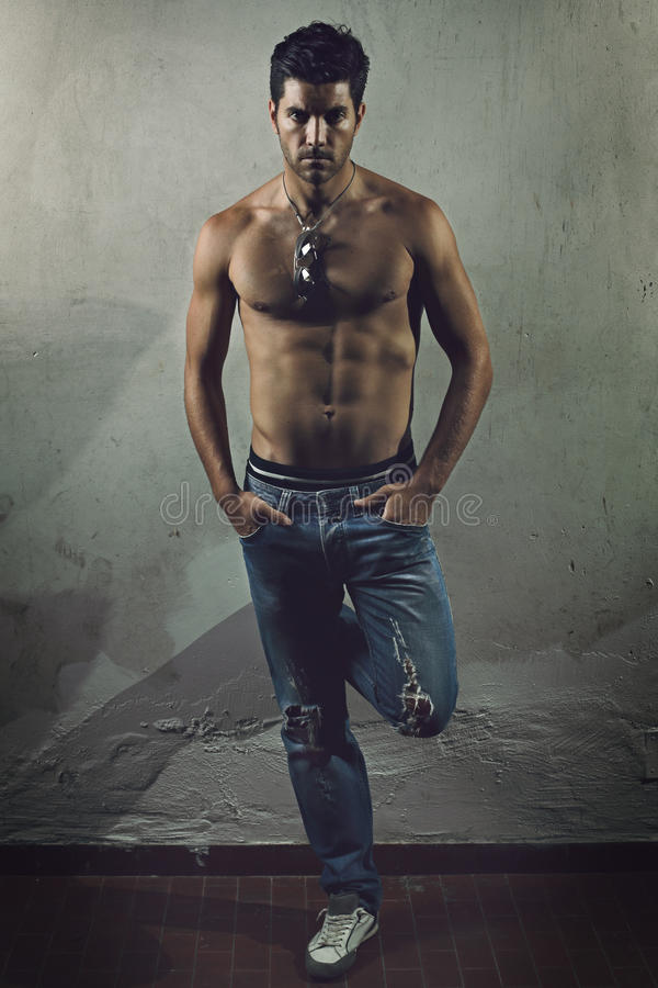 Handsome man with muscular body stock images