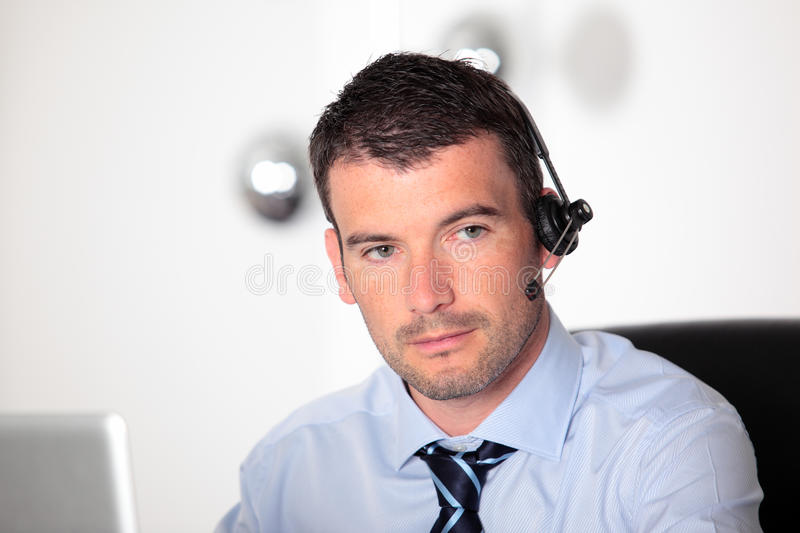 Handsome man in office stock photography