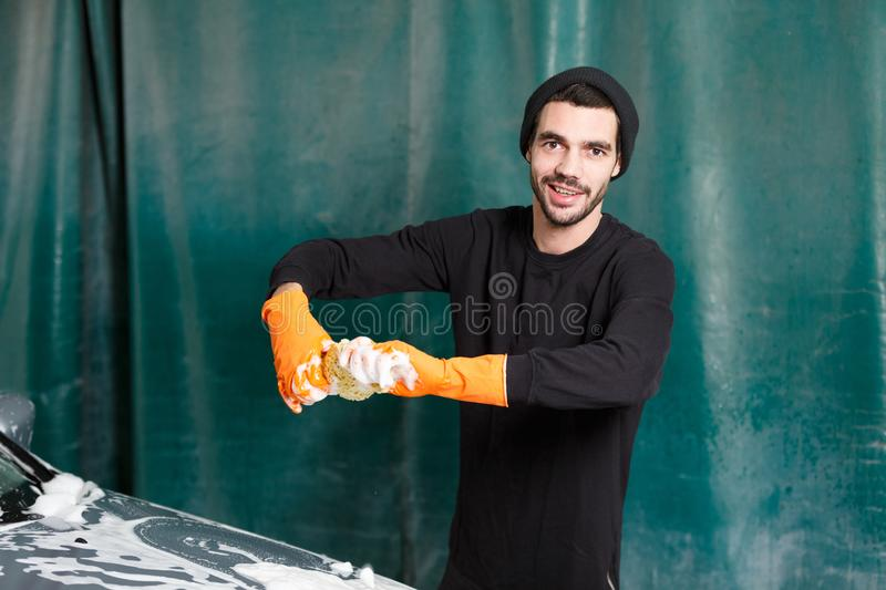 The process of washing a car stock images