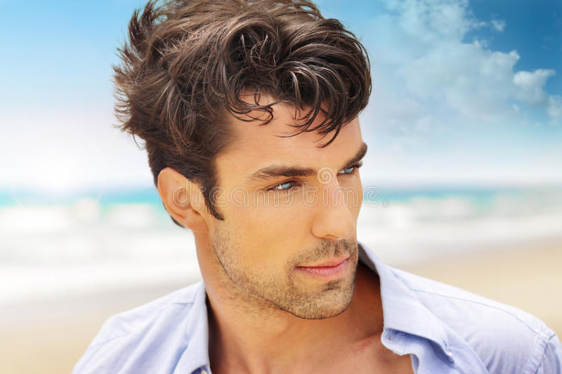 Handsome man outdoors. Outdoor portrait of a good looking young man royalty free stock photography