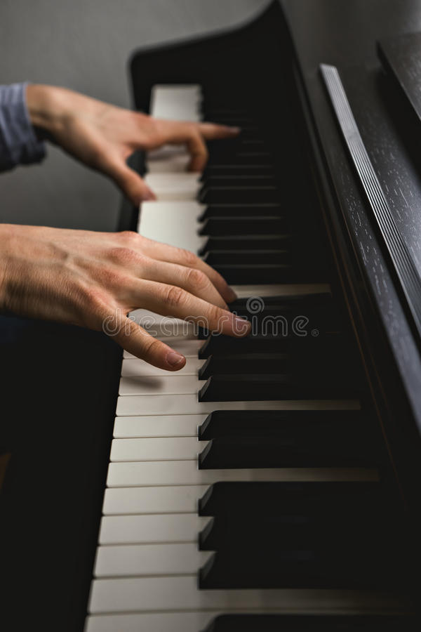 Handsome man plays piano in private royalty free stock image