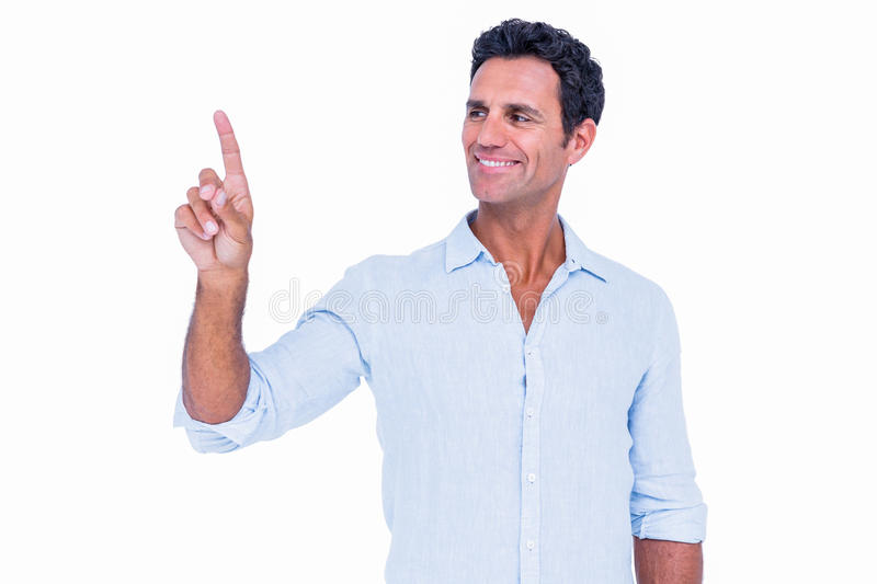 Handsome man pointing something with his finger royalty free stock photography