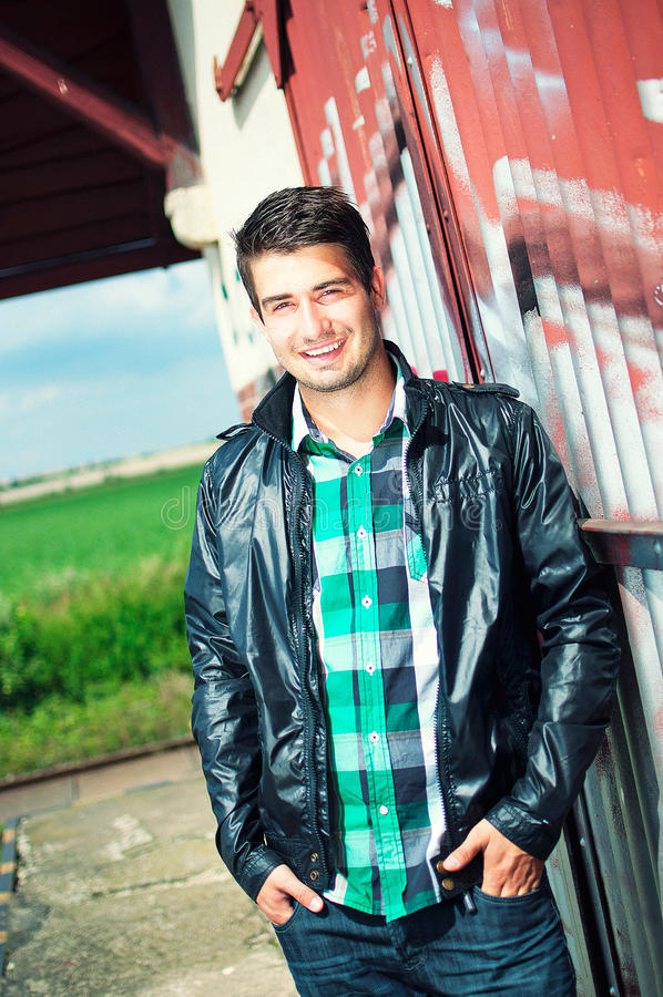 Download Handsome Man Posing Outdoor Over Graffiti Wall Stock Photo - Image: 17725754